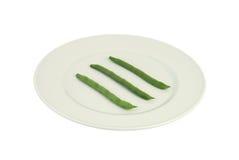 Placa de feijões verdes imagem de stock