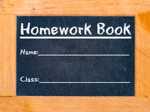 Placa de giz do livro dos trabalhos de casa Imagem de Stock