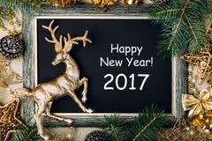 Placa de giz do Natal com quadro dourado Imagens de Stock
