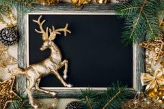 Placa de giz do Natal com quadro dourado Foto de Stock