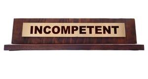 Placa de identificación con el texto de la incompetencia foto de archivo libre de regalías