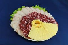 Placa de la carne y de queso fotos de archivo libres de regalías