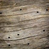 Placa de madeira com furos. Foto de Stock Royalty Free