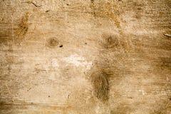 Placa de madeira com uma cara como o teste padrão dado forma Imagem de Stock