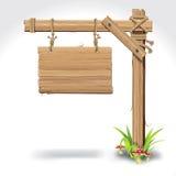 Placa de madeira do sinal que pendura com corda em uma grama. Imagem de Stock