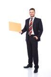 Placa de madeira holded por um homem elegante Imagens de Stock Royalty Free