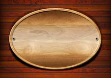 Placa de madeira oval na parede ilustração do vetor
