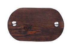 Placa de madeira oval velha com parafusos do cromo Isolado fotografia de stock royalty free