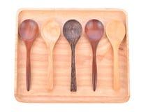 Placa de madera con la cuchara aislada en el fondo blanco Fotografía de archivo libre de regalías