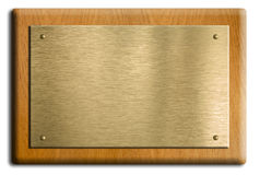 Placa de madera con oro o la placa de cobre amarillo Foto de archivo