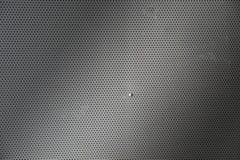 Placa de metal cinzenta com pontos e parafusos Foto de Stock Royalty Free