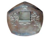 Placa de metal con dos leones y una estrella aislada en blanco foto de archivo libre de regalías