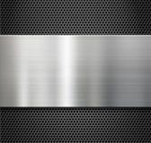 Placa de metal de acero sobre fondo de la rejilla del peine Foto de archivo libre de regalías