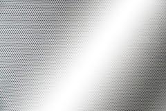 Placa de metal gris con los puntos y los tornillos Foto de archivo libre de regalías
