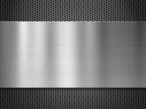 Placa de metal sobre fondo de la rejilla Foto de archivo libre de regalías