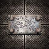 Placa de metal velha na parede metálica Imagens de Stock