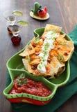 Placa de nachos frescos com queijo Foto de Stock Royalty Free