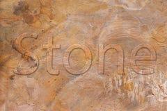 Placa de piedra con una fuente en alivio Foto de archivo