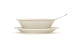 Placa de sopa bege com opinião lateral da colher e do saucer imagem de stock royalty free
