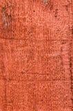 Placa de tapume de madeira áspera pintada vermelho Imagem de Stock