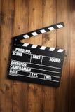 Placa de válvula do filme no fundo de madeira foto de stock royalty free