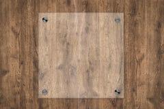 Placa de vidro ou quadro acrílico no fundo de madeira Fotos de Stock Royalty Free