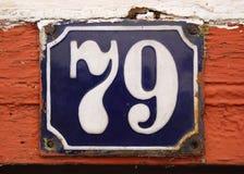Placa del azulejo del número de casa con   Imagen de archivo libre de regalías