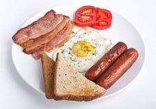 Placa del desayuno con la carne y Fried Egg Foto de archivo