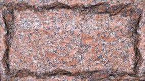 Placa del fondo de un mármol rojo con los bordes dentados Fotografía de archivo