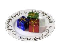 Placa del noel de Joyeux con los rectángulos de regalo chispeantes Foto de archivo libre de regalías