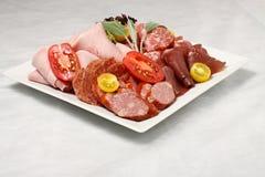Placa del salami Foto de archivo libre de regalías