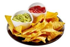 Placa deliciosa dos nachos, da salsa e do guacamole Fotos de Stock