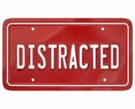 Placa distraída de Word Red License del conductor que manda un SMS conduciendo Dangero Imágenes de archivo libres de regalías