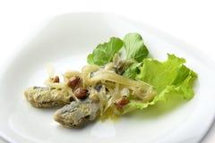 Placa do aperitivo de anchovas postas de conserva peixes Imagem de Stock