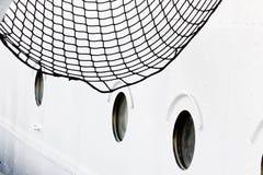 Placa do navio com vigias e rede Fotos de Stock Royalty Free