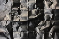 Placa do papel preto amarrotado Textura de papel preta para sua parte traseira fotos de stock royalty free