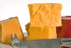 Placa do queijo Cheddar Imagens de Stock Royalty Free