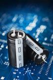 Placa e capacitor de circuito impresso Fotografia de Stock Royalty Free