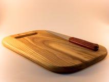 Placa e faca de corte Imagem de Stock Royalty Free