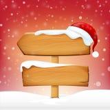 A placa e o inverno de madeira da placa do sinal nevam com espaço e Sant da cópia Imagem de Stock