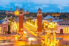 Placa Espanya in Barcelona, Catalonia, Spain. Aerial view of venetian columns, National Art Museum and Placa Espanya in Barcelona at night, Catalonia, Spain Stock Images