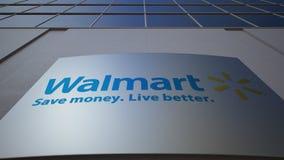 Placa exterior do signage com logotipo de Walmart Prédio de escritórios moderno Rendição 3D editorial Imagens de Stock Royalty Free