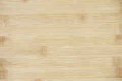 Placa feita da madeira de bambu natural Fundo do teste padrão das texturas na luz - cor marrom bege de creme amarela imagem de stock