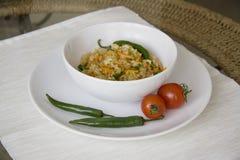 Placa grande del arroz con el espacio grande de la copia imagen de archivo libre de regalías