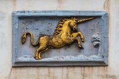 Placa histórica velha da decoração da parede do unicórnio no senhor, Flanders, Bélgica Imagens de Stock