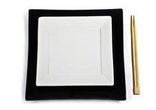 Placa isolada com chopsticks Imagem de Stock Royalty Free