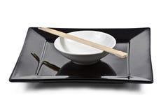 Placa isolada com chopsticks Imagens de Stock