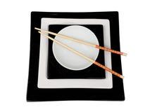 Placa isolada com chopsticks Foto de Stock