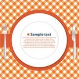 Placa na toalha de mesa Imagens de Stock