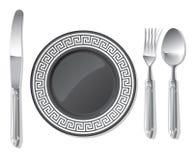Placa negra, cuchara de plata, fork, cuchillo Fotos de archivo libres de regalías